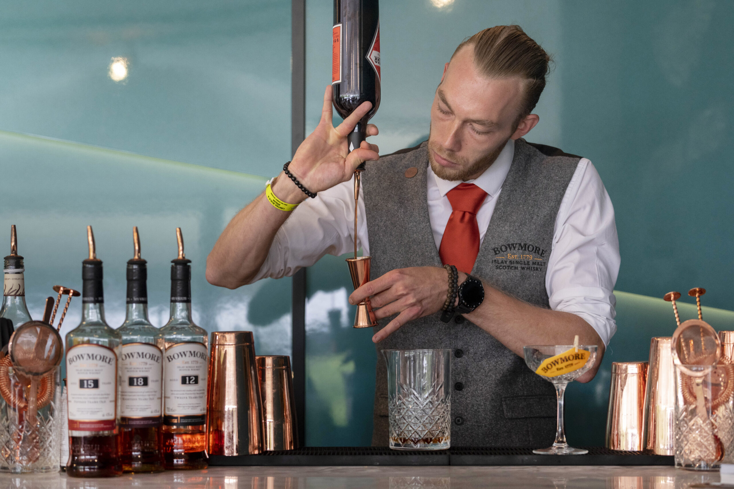 A mixologist from The Cocktail Service at an activation for Bowmore Whisky in the Aston Martin marquee at Goodwood Festival 2021